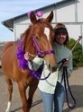 Jody poses with her godfoal on the day he officially became a yearling. Is that like a foal mitzvah?