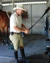 An alleged photo of Hugh cleaning tack is suspected to be fake.